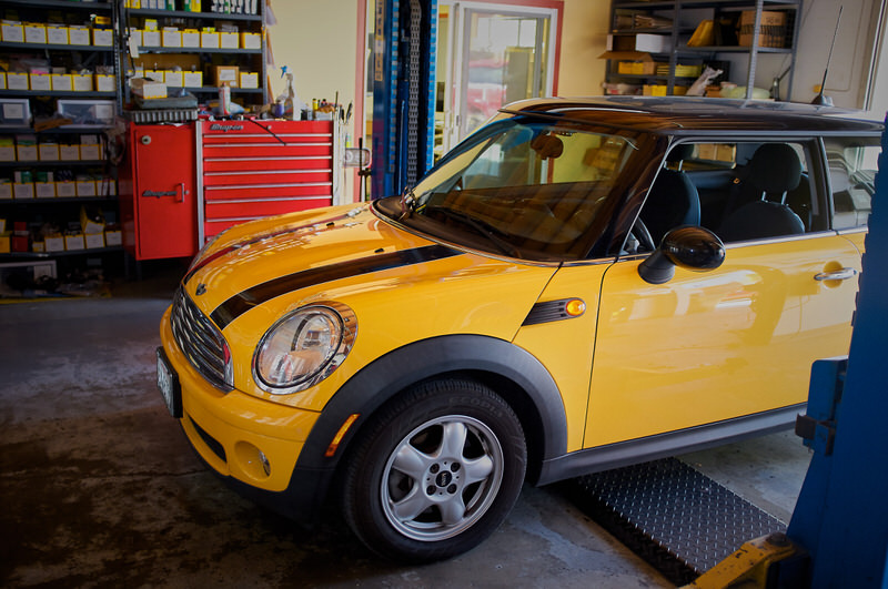 Yellow Mini Cooper for service at Haik's German Autohaus